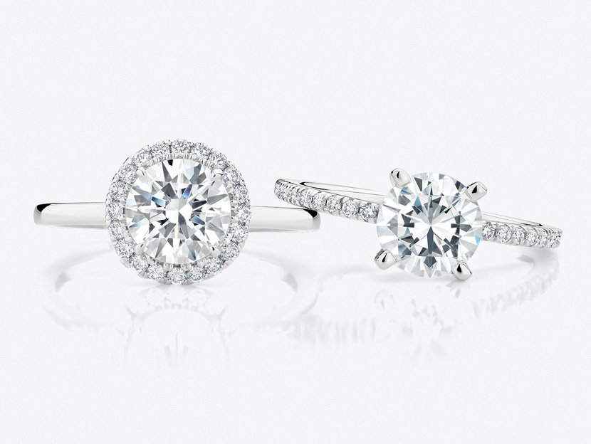 Two classic white gold engagement rings set with lab diamonds