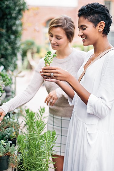 Women smiling and browsing plants