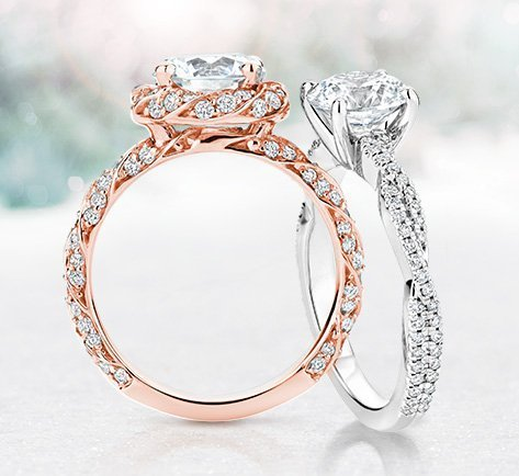 a white gold and rose gold engagement ring leaning on each other - Wedding Rings And Engagement Rings