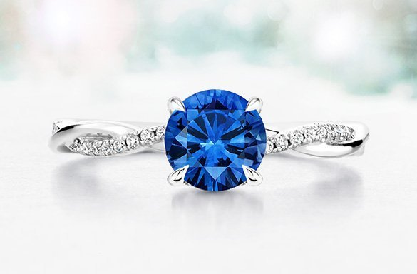 Pave petite twisted vine engagement ring with sapphire center stone