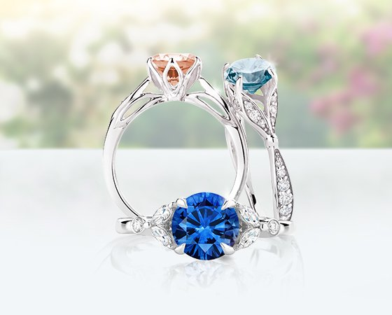 Aquamarine, morganite, and sapphire engagement rings