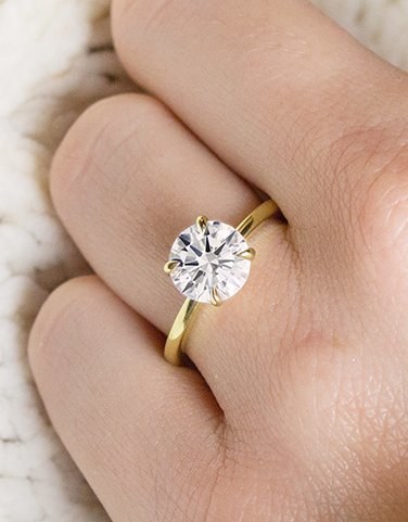 Classic yellow gold solitaire ring