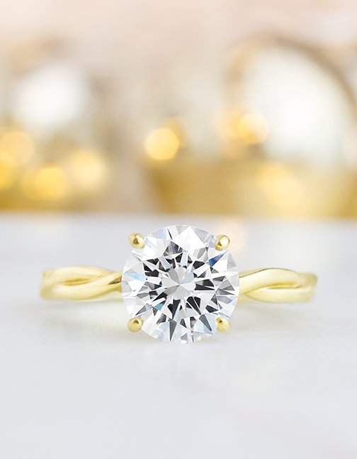 Nature inspired yellow gold solitaire ring