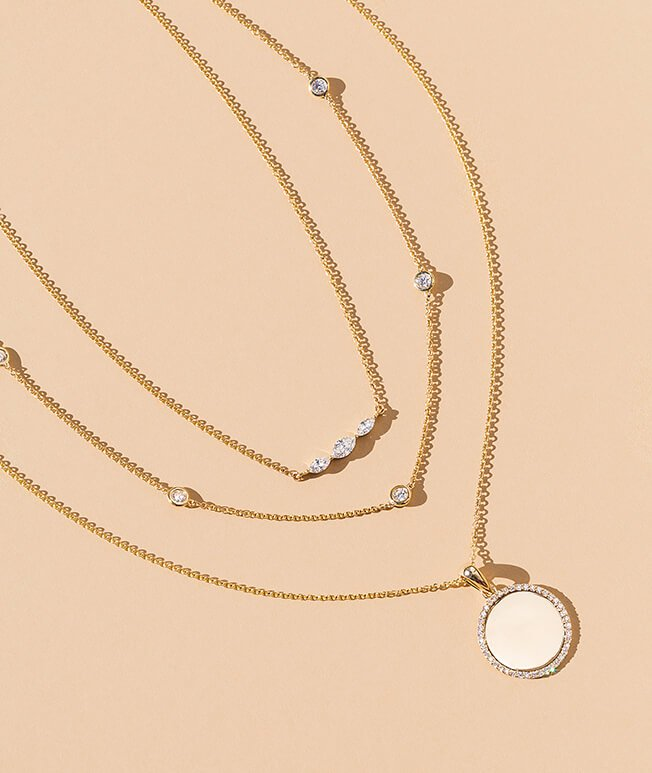 Yellow gold diamond layered necklaces