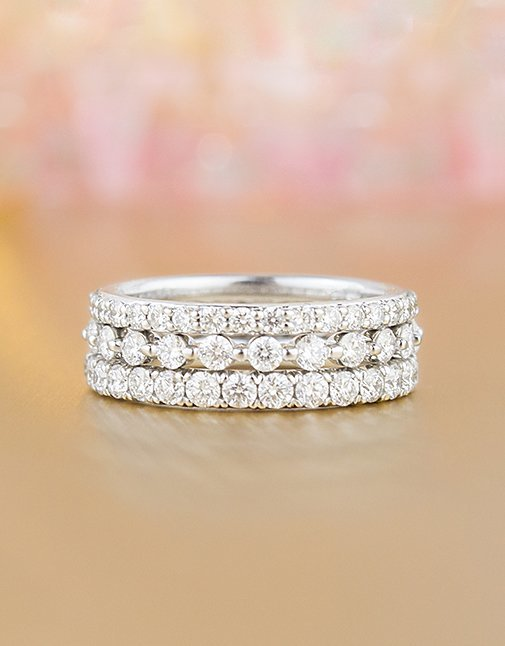 Stack of white gold diamond eternity rings