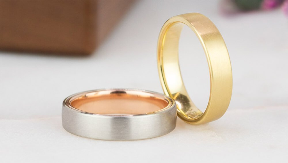 Stack of yellow gold and mixed metal men's wedding ring
