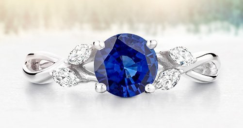 Nature inspired engagement ring with sapphire center stone