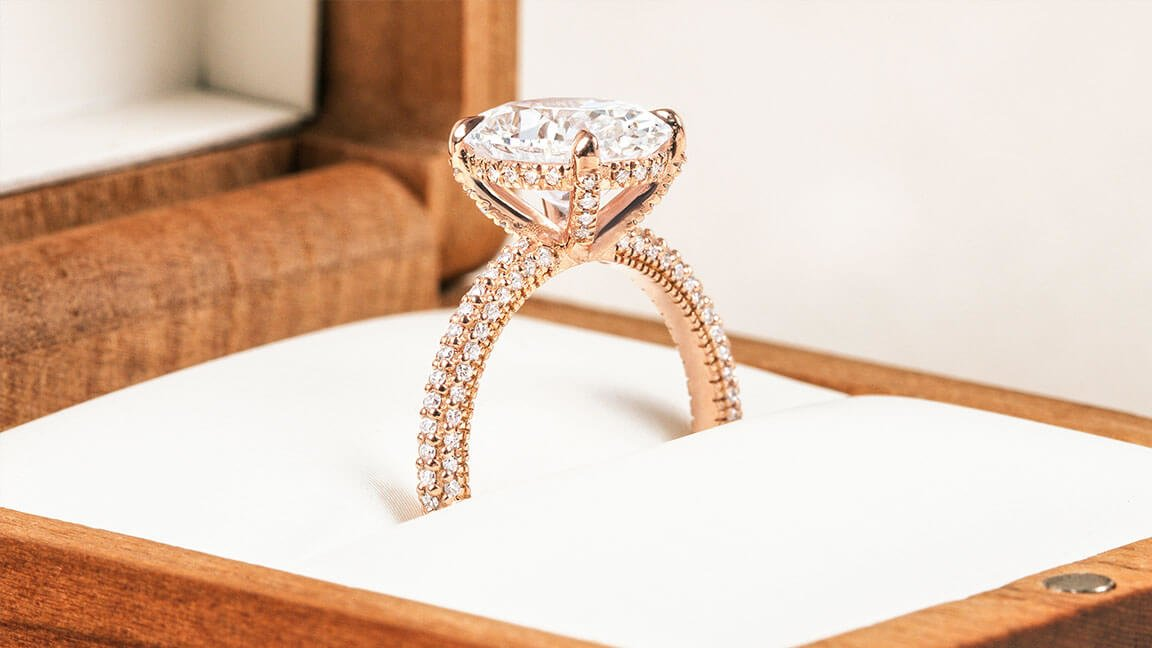 Rose gold diamond engagement ring with surprise diamond details